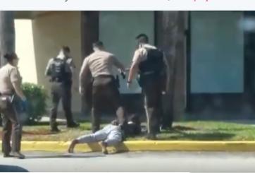 VIDEO: Policía patea a adolescente en la cara mientras está esposado
