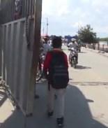 Niños cruzan a estudiar