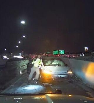 VIDEO: Oficial casi fue arrollado por su propia patrulla tras choque