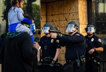 Policía apunta arma a hombre que llevaba a su hija sobre los hombros
